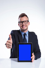 business man recommends his tablet