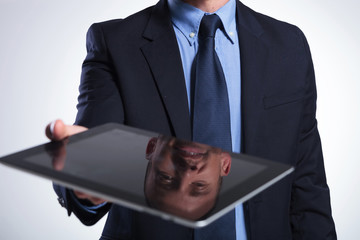 business man's reflection on tablet