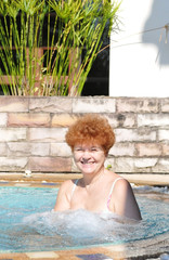 Happy senior woman in spa