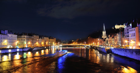 Saone River with boat sailing by night