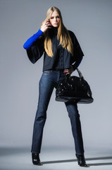 full-length fashion girl with handbag posing