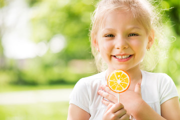 Portrait of Cute Little Girl with Lollipop