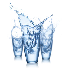 Water splash in glasses isolated on white background