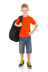 young boy carrying schoolbag