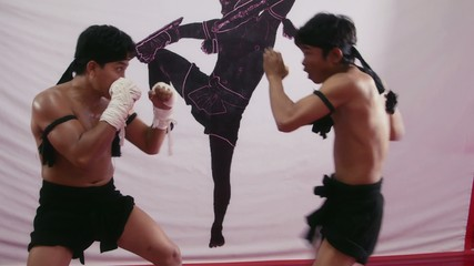 13of20 Asian man training kickboxing in gym as fighter