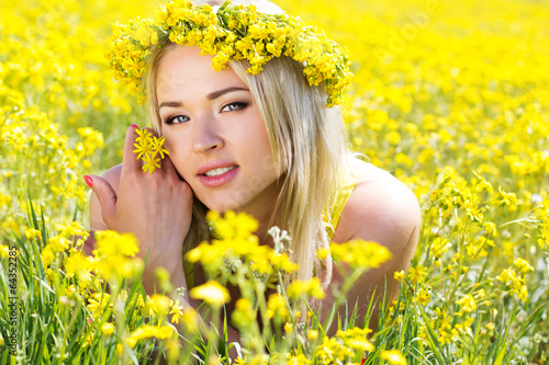 Young beautiful girl in the yellow field