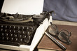Typewriter with antique book and eyeglasses,