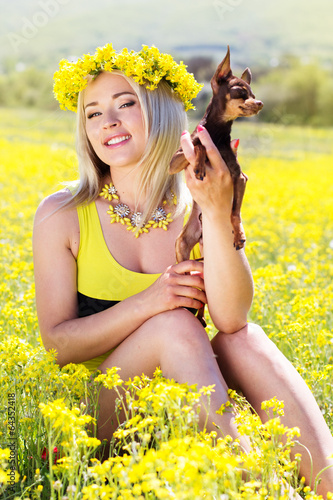 Pretty girl on the nature with her dog