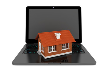 3d House over Laptop keyboard