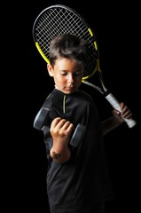 Portrait of handsome boy with tennis equipment