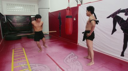 16of20 Asian man training kickboxing in gym as fighter