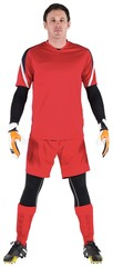 Goalkeeper in red looking at camera