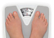 Female feet on broken bathroom scale