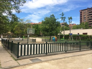 Playground, buildings and trees