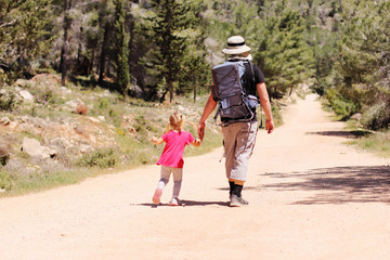 Father hiking with kid
