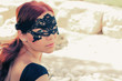 portrait of beautiful woman in mask outdoors