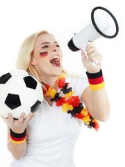 Girly soccer fan shouting loud through megaphone