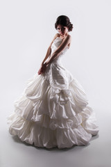 Fashion beauty bride woman in magnificent wedding dress isolated