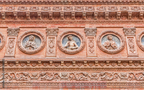 Bologna -  Detail from facade of little renaissance chapel