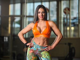 beautiful woman on the gym posing
