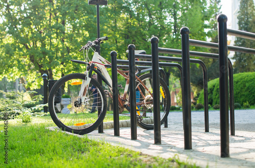 Bicycle parking with a parked bike - 64362096