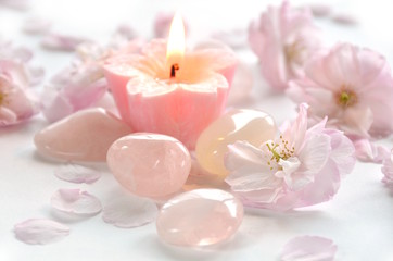 gemstones with candle and flowers