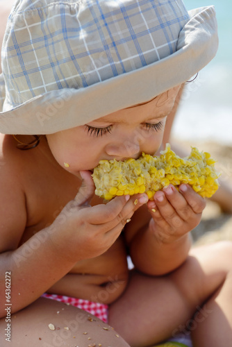toddler eating corn