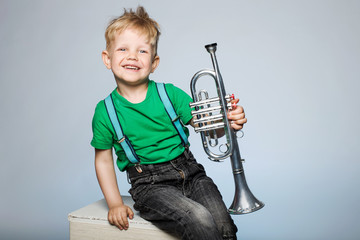 Happy child with trumpet