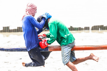Thai boxing (or Muay Talay) - ancient Thai fight above the sea
