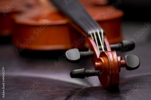 Classic old violin vintage on the leather background
