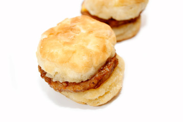 Close-Up of a Hot Sausage Sandwich with Biscuits