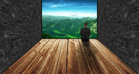 Man sitting in a room with a fantastic view