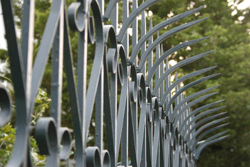 a garden fence in front of a house