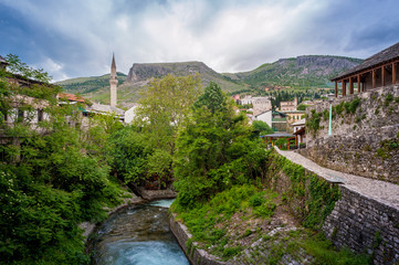 Old town of Mostar. Islamic architecture with river running