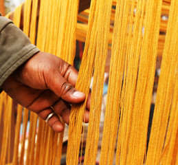 cloth thread checking in dilli haat shop