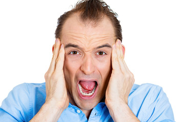 Closeup portrait, headshot Angry young man screaming