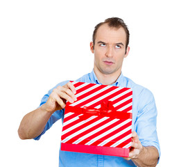 Bad gift idea. Young Man displeased with a gift he received
