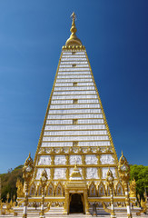 close up white and gold thai pagoda in thailand
