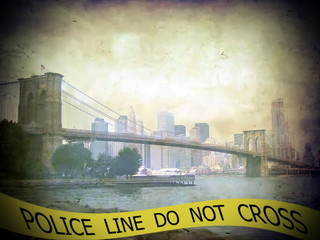 Police line do not cross sign tape on view of Brooklyn bridge