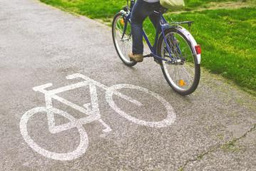 Woman riding bicycle on a bike path
