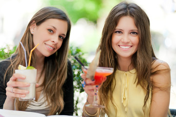 Two girls having an aperitif outdoor
