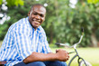 african man relaxing at the park