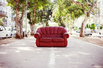 red vintage leather sofa on the street