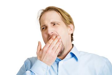 Yawning, stretching, tired business man