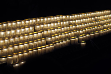Candles in a row in Notre Dame de Paris