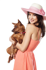 happy young woman holding her little dog in her hands