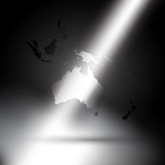 Australia map in rays of light on gray background