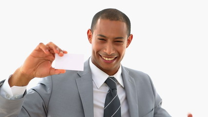 Happy businessman showing card