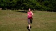 Fit woman sprinting past the camera