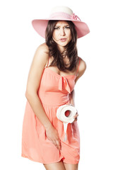 pretty girl with a hat in a short dress has a need for toilet
